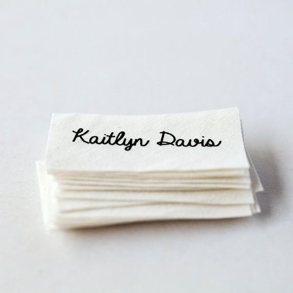 Sew-in custom clothing name labels, printed on white organic cotton and pre-cut.  1. Select font (from last photo) and size/quantity at checkout (default is 20 2 x 1 labels, but there are many additional options). You can choose custom for the font and leave the name of a different font in notes to seller if you prefer. 2. Leave name you want printed in notes to seller section at checkout. 3. Get labels!  There is an option when you purchase to choose the size and quantity of labels you…