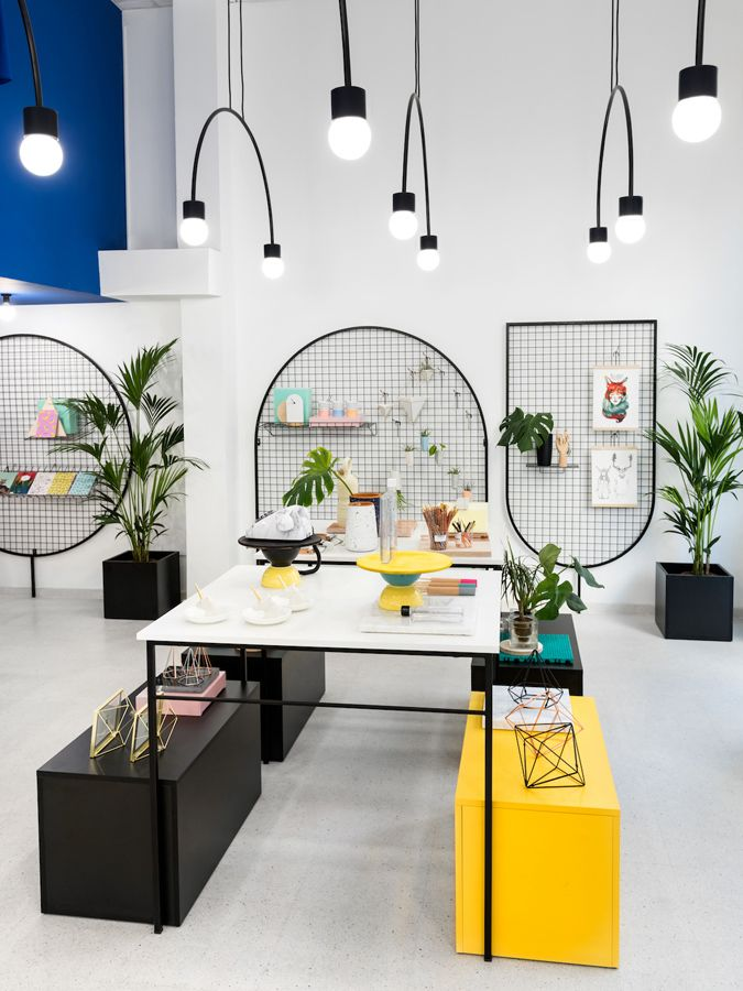 VALENCIA – Bright pops of pink, blue and yellow juxtaposed with monochrome stripes adorn the entrance of lifestyle store Gnomo, setting the scene for the playful retail environment that lies ahead. Spanish creative agency Masquespacio pays respect to the 80s aesthetic of the space while injecting a contemporary touch. Masquespacio's creative director Ana Hernández says, 'Taking into account that Gnomo sells different kinds of objects from a wide set of brands, it was important to create a…