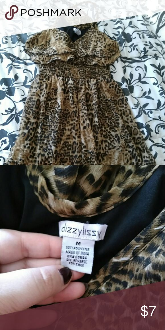 """🆑EARANCE! Leopard Print Junior Size Dress NWOT Size: Medium Brand: Dizzy Lizzy *NECKLACE NOT INCLUDED*  Cute leopard print dress It is short, good with tights or without Has a scrunge waist line to give the effect of small waist The top part has two frilly layers & the bottom as well Straps criss cross """"X"""" on back  *BUNDLE WITH OTHER ITEMS FOR DISCOUNT & MAKE A OFFER ON BUNDLE!* Dizzy Lizzy Dresses Mini"""