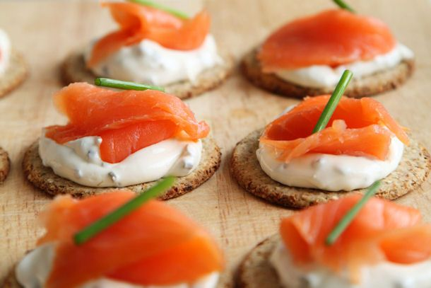 salmon-canapes - i like the way these look - simple and delicious. the recipe calls for it atop jicama slices, but this pic is a cracker, which I would prefer