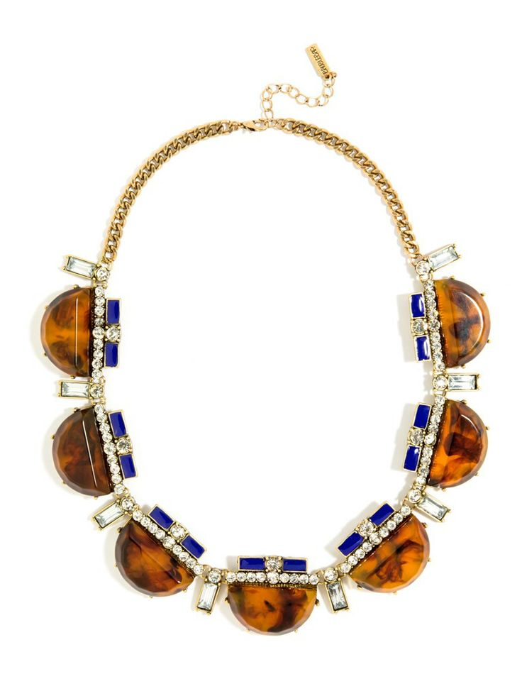Dial it back to the glorious Art Deco era with this striking statement necklace. With its cool graphics and dazzling mix of gems, this style's planted firmly on our must-have list. Plus, we love those sweet bow-like toppers.