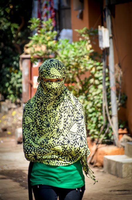 Burga with style Photo by Carl LaCasse -- National Geographic Your Shot  ady walking down a street is a suburb of Mumbai.
