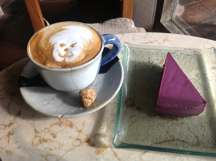 Hanuman in a cappuccino and raw cheesecake at Kafe in Ubud