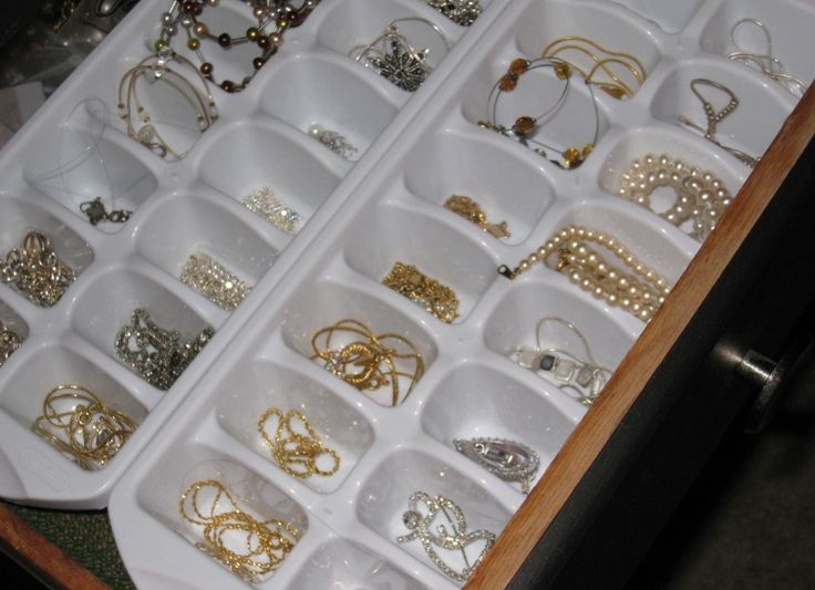 Ice cube trays or egg trays in drawers for jewelry storage