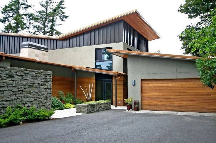 Modern Exterior Of Home With Raised Beds Pathway Transom Window Metal Siding Horizontal Wood