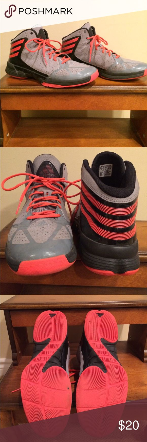 Men's Size 11 Adidas high top basketball shoes. Men's Size 11 Adidas high top basketball shoes. Still some life left in them and in good condition. Grey, black, and orange in color. Adidas Shoes Athletic Shoes