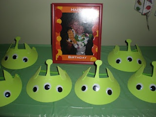 Toy Story alien hats - made from foam visors and googly eyes!  Cheap and cute!