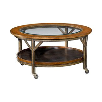 Combining Wood And Metal Textures, This Beveled Glass Top Coffee Table  Features Casters For Easy