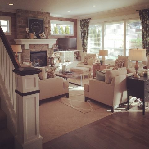 Beautiful family room with stone fireplace and neutral shades eclecticallyvintage.com