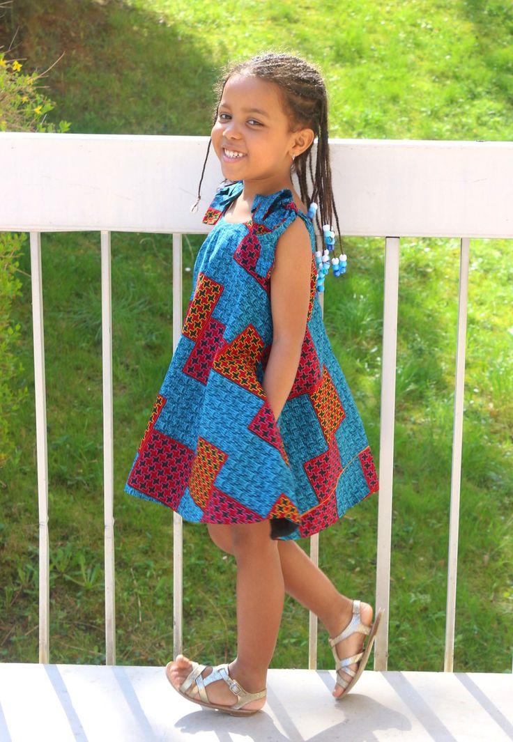 Robe pour fillette avec noeuds sur les épaules en wax bleu par Tys-jewel pour Afrikrea. https://www.afrikrea.com/article/robe-evo-enfant-vetements-enfants-bleu-pour-elle-coton-wax/8Y1KEZ1?utm_content=bufferd4b88&utm_medium=social&utm_source=pinterest.com&utm_campaign=buffer