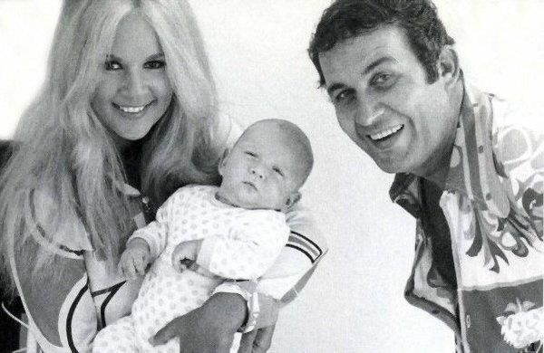 Aliki Vougiouklaki and Mihalis Papamihael with their son