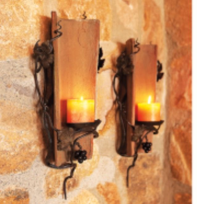 Salvaged terra cotta roof tiles made into candle sconces