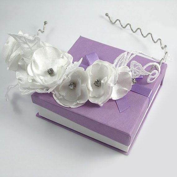 Check out this item in my Etsy shop https://www.etsy.com/listing/196161536/bridal-flower-hair-band-satin-flowers