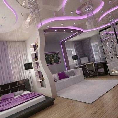 Awesome room with a couch and fancy, purple lights