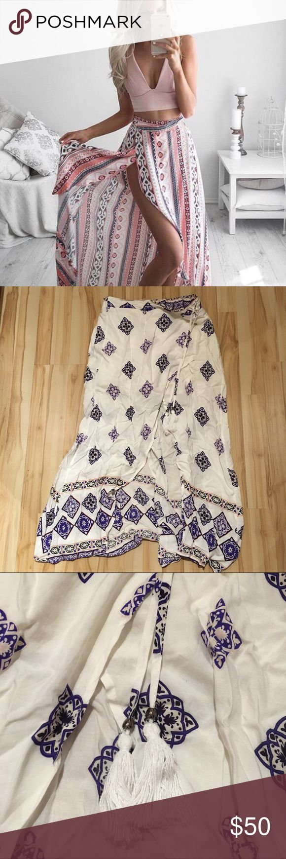 """LF Tribal maxi skirt White and blue LF maxi skirt with slit front and tie detail. Gorgeous and perfect for summer! Lined half way, slit to mid thigh, faux tie detail, elastic waist. Like new! First picture is to show style only! Medium, but can fit small. I'm 5'10"""" so this doesn't come all the way to the ground on me, but about ankle length. Would be longer on someone shorter. LF Skirts Maxi"""