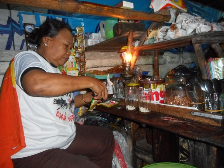 """A lady were making """"kopi joss"""", a coffee with hot charcoal."""