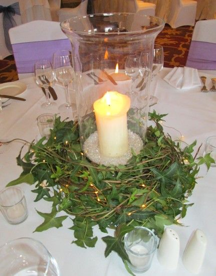 Hurricane vase with ivy base surround and fairy lights