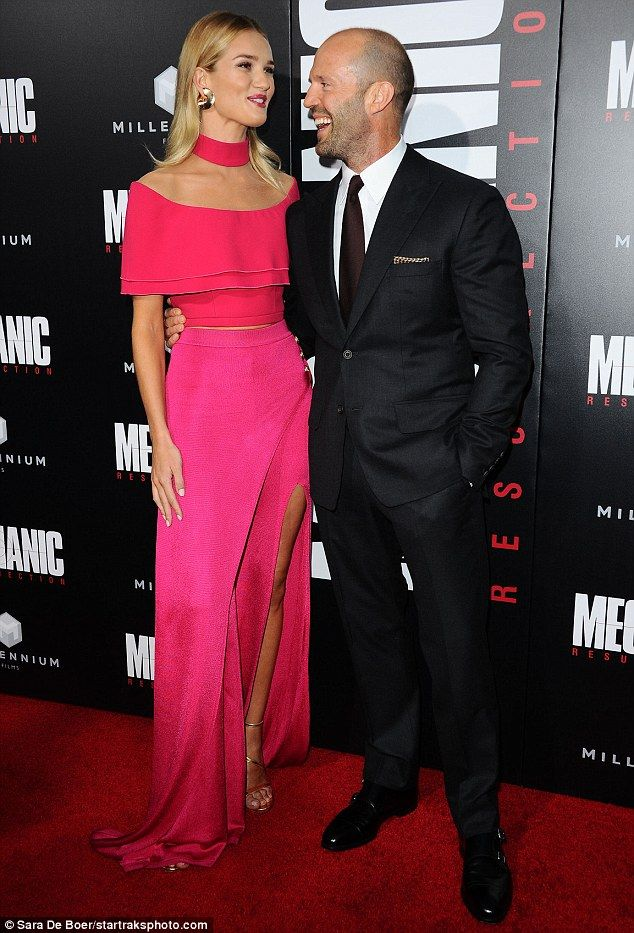 By his side: Rosie Huntington-Whiteley, 29, proudly supported fiance Jason Statham, 49, at the premiere of his new film, Mechanic Resurrection, in Hollywood on Monday