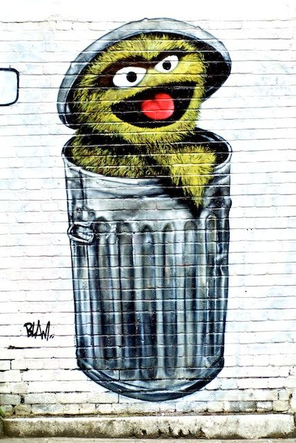 By Blam / Blam was responsible for one of the most photographed pieces of street art in East London around 2008 - an Oscar the Grouch well placed between some large dumpsters on Old Street.