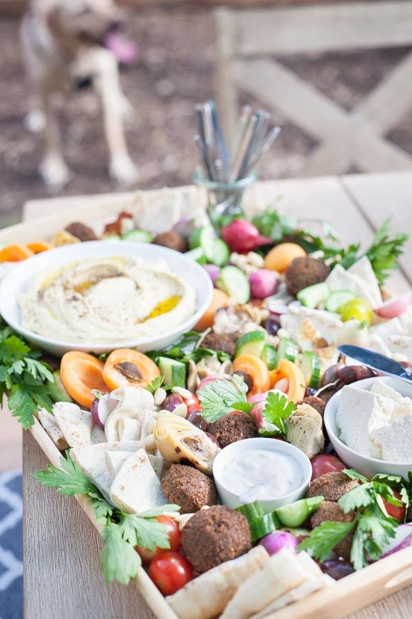 Ultimate Mediterranean Hummus Platter | BourbonandHoney.com -- This Mediterranean Hummus platter is the ultimate party appetizer. No need to make anything from scratch, just throw together your favorite ingredients for a seriously simple yet impressive snack.
