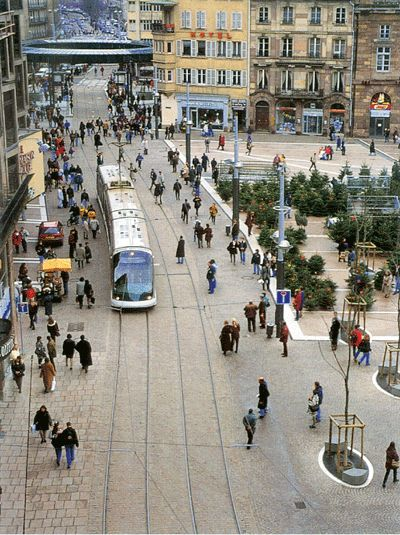 Tram and pedestrians share space in Strasbourg, France, where use of public transport has increased by 40 percent since 1990.