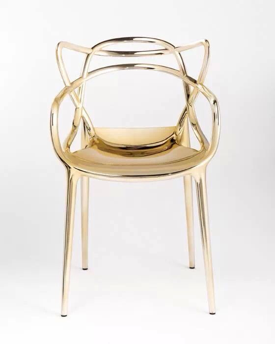 Kartell gold chair - made of plastic, revealed at the Salone del Mobile 2014, in Milan.
