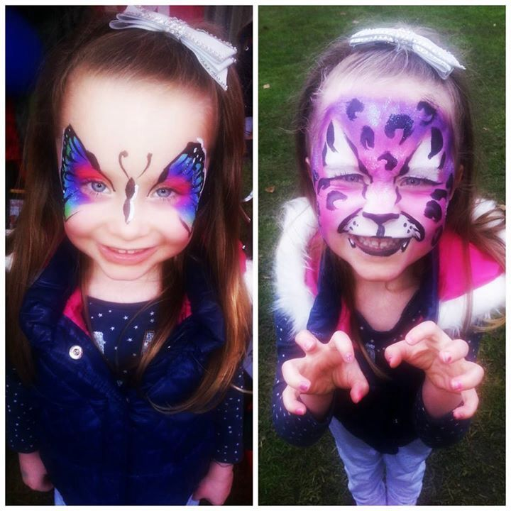 Identical twins? Not today. Face painted rainbow butterfly and purple leopard.