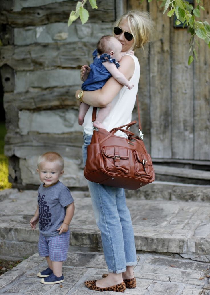 """You'll never believe this is a diaper bag! """"I'm sporting the super roomy Elizabeth that can be converted to a backpack."""" Lily Jade created designer diaper bags that are gorgeous and hardworking. Just. Like. You. They make the perfect gift for the organized woman."""