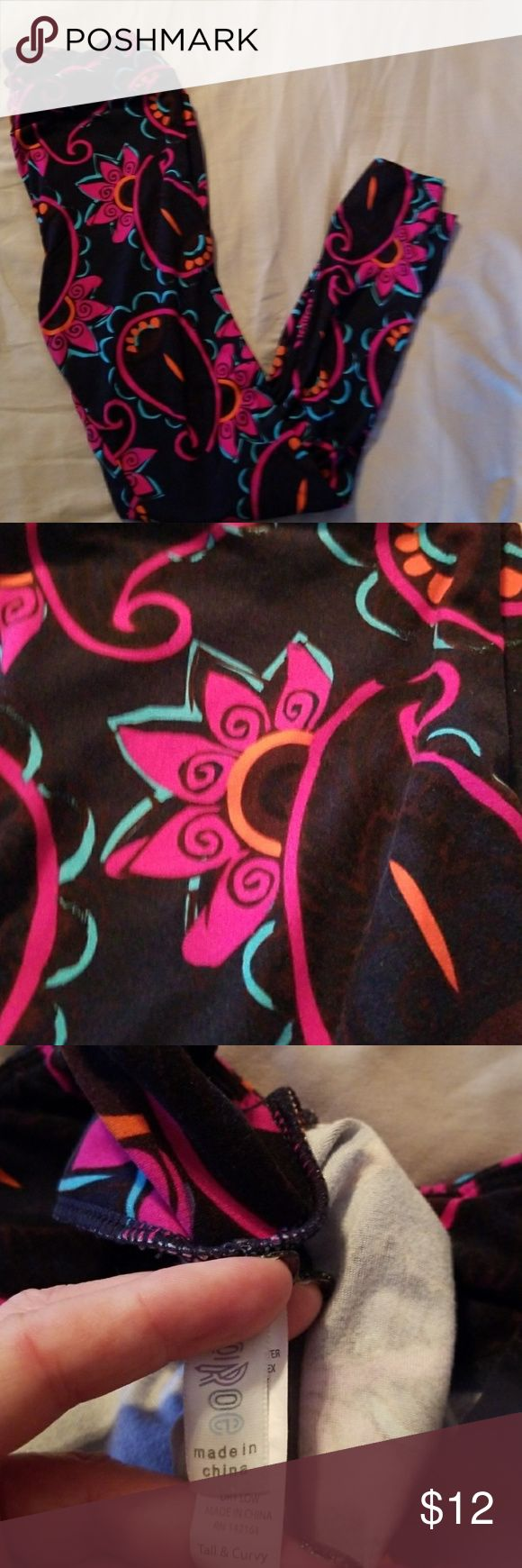 Lularoe TC leggings Navy background with hot pink, real and orange design.  Great condition.  Slight wear in the crotch area as shown.  Smoke free home. LuLaRoe Pants Leggings