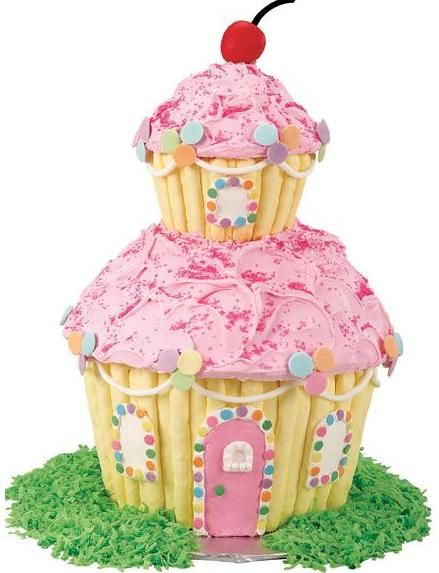 Candyland cupcake cottage by wilton candyland cottages for Cupcake home decorations