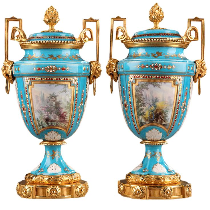 English Porcelain vases and gilded bronze mounts resting on a circular base with fine fluting and floral patterns. France 1880