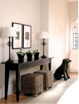 entryway decorating ideas | Entryway by flora (wood color right - seats underneath helpful - would be good to have drawers in the table - fotos of family and or mirror over table)