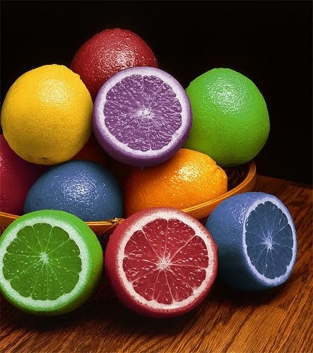 Multi-colored lemons - love this idea. You put pin-pricks into the lemons (all the way through the rind and into the flesh of the fruit), dunk them into a bowl of colored food coloring for a while -- and voila! I'm guessing the rinds probably won't come out that perfectly white, but it's worth a try!