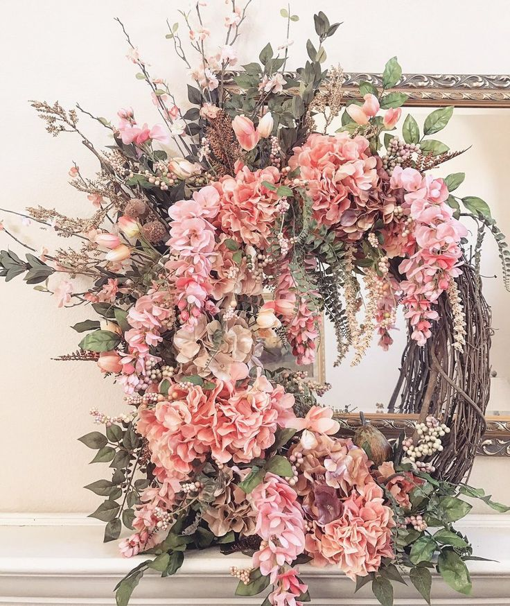 Grapevine WreathPink, beige, & tan hydrangeas, pink tulips, pink hanging orchids, cherry blossoms, acorns, green leaves, and flower accents (Flowers are art