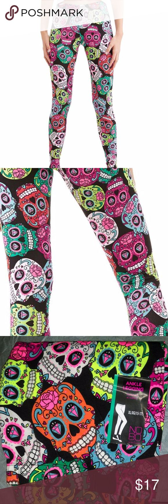 "NEW~Sugar Skulls~Day Of The Dead~Leggings~L 11-13 I love these leggings! They're so colorful. Made of 95% Cotton, 5% Spandex, so there's lots of stretch. Colors are black background with multi bright colors of pink, fuchsia, aqua, teal, yellow and white. Beautiful combination that really works. Perfect for Halloween! I'm keeping a pair for myself and these will be my ""costume"" this year! Size L (11-13) NOBO Pants Leggings"