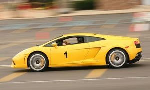 Groupon - Three-Lap High-Speed Driving or Ride-Along Experience in Ferrari or Lamborghini from Imagine Lifestyles (Up to 60% Off) in Candlestick Park. Groupon deal price: $99