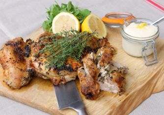 Flattened chicken. Our local butcher takes out all the bones, we stuff herbs and garlic under the skin and served on rustic wooden boards in slices – or your guests may carve it themselves, we supply the knives, you supply a pinny and a hat – all very sociable.