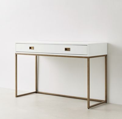RH TEEN's Avalon Desk :The sleek lines of our collection exemplify the sophisticated restraint of modernism, while its polished cast-brass fittings – including recessed pulls and a metal base – take the composition in a stunning new direction.