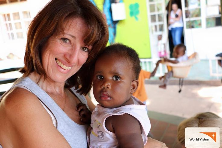 Global One trip participant Sally helping out at a Babies Home in Kampala, #Uganda. You can go overseas with #WorldVision in 2015 and 2016.