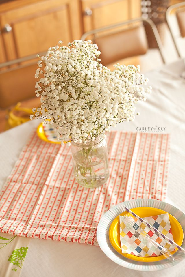 Table center pieces? We have plenty of Mason jars! And babys breath is cheap!