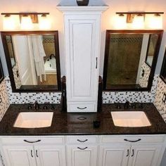 Small storage between vanities. Hide outlets inside along with curling iron, blow dryer and flat iron storage!