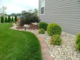 Image result for landscaping with rocks around house