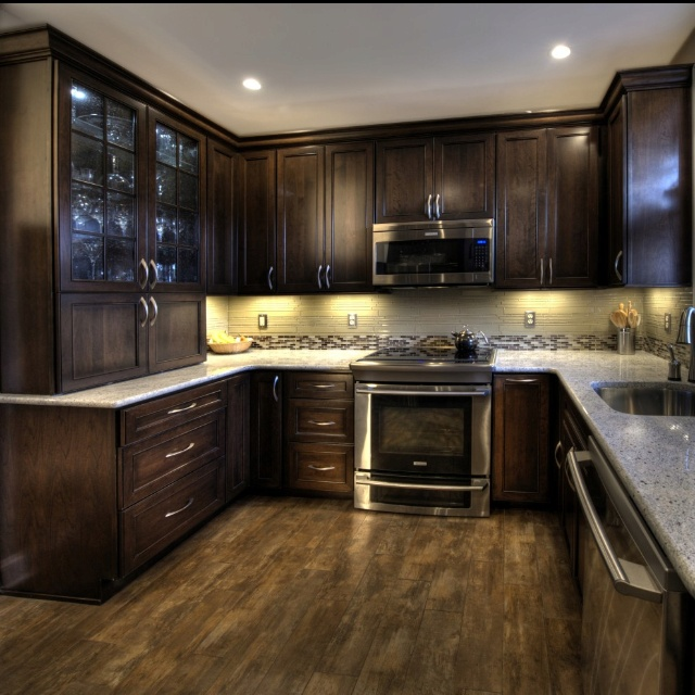 Cherry cabinets with a mocha finish kashmir white granite for Dark wood cabinets small kitchen