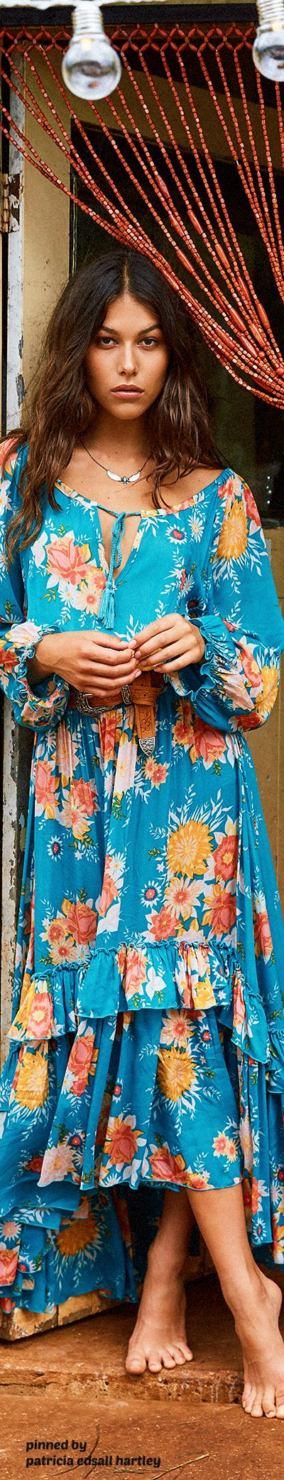 Romantic long boho dress in a great shade of blue with floral print and ruffled flounce