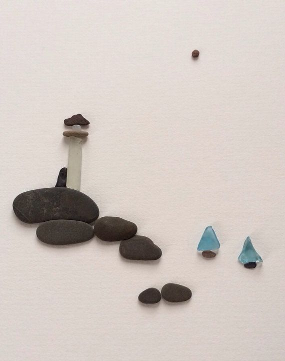 Love this: art made of pebbles and sea glass. Lighthouse and sailboats. Adorable. Artist: Sharon Nowlan.