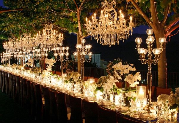 Absolutely gorgeous! The chandeliers and lighting make this almost look magical!