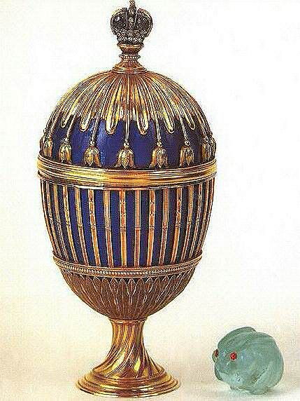 Blue Enamel Ribbed Egg ca. 1885-1891 made of green, red and yellow gold, sapphires, diamonds and translucent royal blue enamel.  the minature rabbit is made of aquamarine and rubies.  It is suspected that the Egg today is much changed from its original appearance.