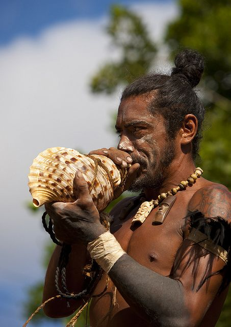 Warrior Blowing n A Shell During Carnival, Tapati Festival, Easter Island, Chile by Eric Lafforgue, via Flickr