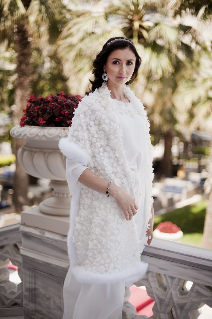 Gorgeous white shawls from lace and fur with 3D flowers, exclusively at #ADAMOFUR stores and via What's App #shawl #silk #bride #wedding
