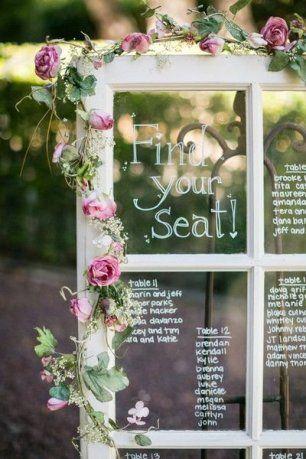 План рассадки гостей в виде оконной рамы украшенной цветами